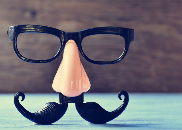 47485293 - a fake mustache, nose and eyeglasses on a rustic blue wooden surface